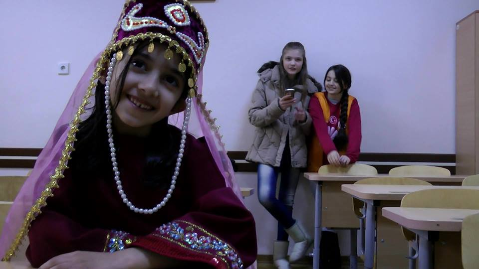 One of his students wearing the Armenian Taraz (traditional custom)