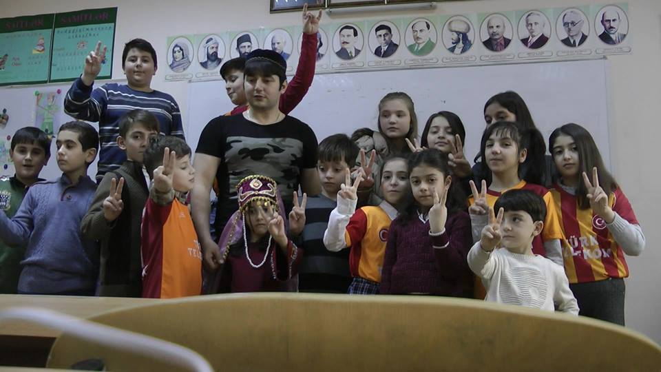 Roshan Azizov with his students.